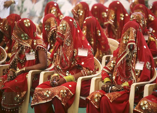 Brides wait for the start of their marriage ceremony